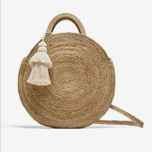 Round straw bag with large tassel, worn once